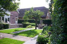 tuin tuinontwerp tuinarchitect hovenier hoveniersbedrijf tuinaanleg beplanting beplantingsplan onderhoud villatuinen gazon trap hoogteverschil fruitboom terras