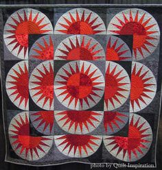 """Points of Pride, 76 x 76"""", by Kim Noland, quilted by Linda Adamcik.  2015 World Quilt Show. Photo by Quilt Inspiration"""