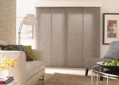 Panel Track Blinds for Modern Decor Larger fabric panels on panel track blinds make them easier to use and lend a modern flare to your room's decor. Sliding Door Blinds, Sliding Panels, Sliding Glass Door, Panel Blinds, Curtains With Blinds, Valance, Blinds For Large Windows, Budget Blinds, Coastal Living Rooms