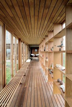 YES - Love this hall way / passage. Open, light-filled, shelves. Directionality of the wood panels draws you in