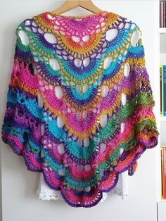Best 12 Examine our wide selection of females' jacket inclusive of puffer top, down top, quilted jacket. Crochet Woman, Love Crochet, Crochet Shawl, Crochet Lace, Crochet Capas, Poncho Outfit, Rainbow Crochet, Crochet Triangle, Lace Wrap
