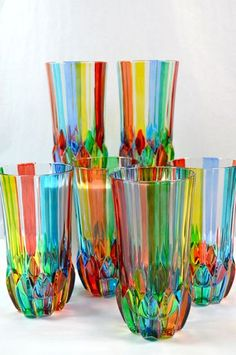 Vibrant colors are hand painted on this Italian crystal glassware. These gorgeous water glasses can be used to brighten up any table or bar.  Mix up your favorite drink and serve in style.   Each glas
