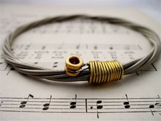 Recycled Bass Guitar String Bracelet silver colored with brass ball end attached Mens or Womens MEDIUM on Etsy, $29.95