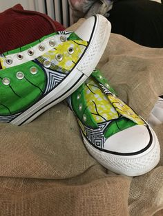 I covered a pair of Chuck Taylor's in African print for a client