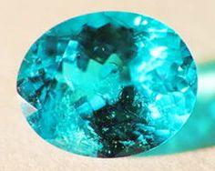Paraiba tourmaline - I've seen these in person, and this is just about the color they can be - you can see the color from 15 feet away!