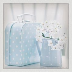 Pale blue polka dot luggage. Beautiful.