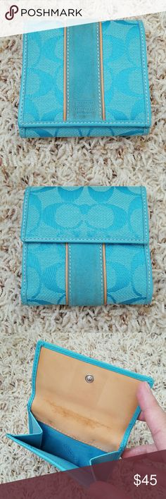 """Coach Signature Wallet This wallet features turquoise blue Coach Signature prints, coin holder, card slots and cash slots, snap closure. Pre-loved with signs of use on the exterior leather strip and coin holder. Dimensions when closed and flat is 4"""" x 4.25"""" x 1"""". Dimensions when opened is 4"""" x 7.25"""". Coach Bags Wallets"""
