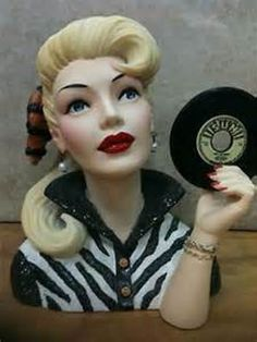 Head vase with old 45 record.