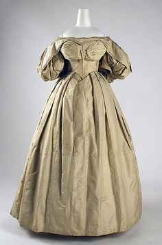 Dress    Date:      1831–34  Culture:      American (probably)  Medium:      silk  Dimensions:      Length at CB: 48 1/2 in. (123.2 cm) Length at CF: 47 in. (119.4 cm) Width at Bottom: 105 in. (266.7 cm)  Credit Line:      Gift of Art Worker's Club, 1945  Accession Number:      C.I.45.68.2a, b