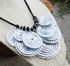 Spiral Disc Bib Necklace - crafted of aluminum wire (so it is not heavy) on deerskin cord- $49, Design by Kara Mavar of Karisma by Kara Jewelry (Designs in Aluminum & Copper) via Etsy.