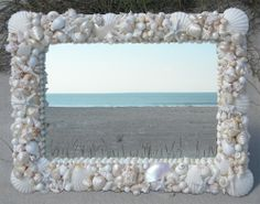 I've contemplated doing this to my large dining table mirror - who doesn't love a seashell mirror?
