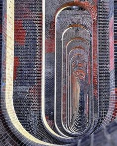 Through the arches of the Balcombe viaduct. Extraordinary early 19th century architecture. Photo taken in West Sussex, England.…
