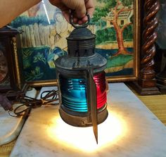 Where can you buy an ANTIQUE 1913 NAUTICAL MARINE RED and BLUE LENS BOW SIGNAL LANTERN LAMP? Here and as you can see it lights up real pretty! https://www.etsy.com/listing/386774266