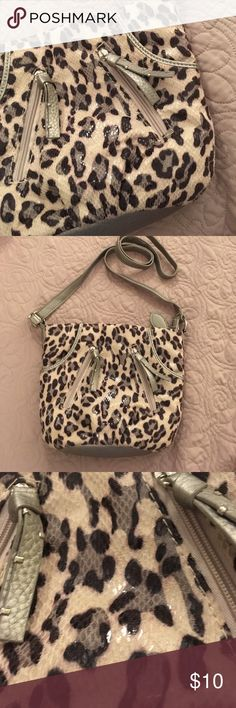 🗝Cross body animal print purse Excellent used condition cross body purse. Animal print. The material is soft. It's not suede but feels a little like it. The material has a shine to it as well. There are 4 small pockets on the front and two in the back. The strap is 52 inches fully extended. There is no brand label inside. Roomier than it looks. Peach blouse available in my closet too. Bags Crossbody Bags