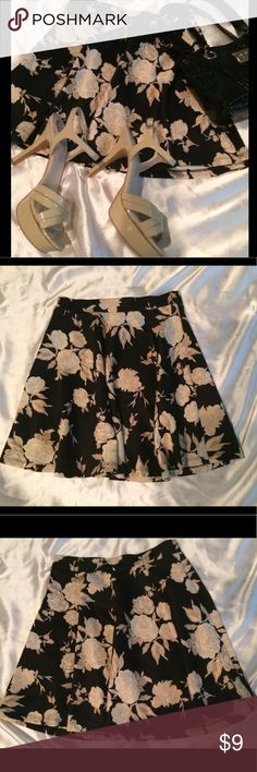 Forever 21 Black Cream Floral Fit Flare Skirt Sz S Cute pre-owned Forever 21 Black With Cream Floral print.  Fit & Flare look.  Size Small.  The inner back tag was cut off but the material/washing instruction tag with forever 21 on it is still on (see photos).  This is in great condition only worn 2x. Length 16 inches, waist flat 12 inches. Very good material doesn't wrinkle.  95% Polyester/5% Spandex/Elastane. Hand Wash Cold, Dry flat.  Don't forget to bundle & save!  Check out my closet…