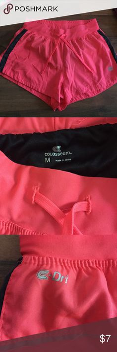 Coral athletic shorts Like new zipper in the back pocket black coral and thin stripe of gray Shorts