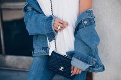 Oversized Denim Jacket with a simple white tee and jeans. Accessories: Chanel Wallet on a chain, IceLink ring | Fall fashion | Minimal Outfit | www.suzysogoyan.com
