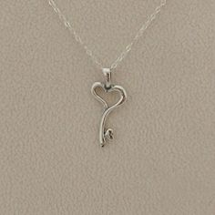"""Sterling Silver Key to My Heart Pendant Necklace Sterling silver key to my heart pendant measures 12mm x25mm. The heart key evokes the feeling of unending love. The pendant is on a pretty 18"""" sterling silver 1.5mm cable chain. New.  Measurements are approximate. Photos may be enlarged to show detail. Jewelry Necklaces"""