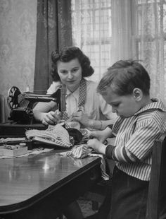 dollmixture:    Doll seamstress Josephine Gloss sewing alongside her 4-yr.-old son, at home 1947