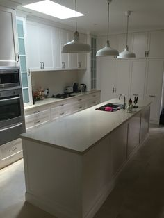 Polyurethane finish on profile doors and drawers with stone bench tops and tiled splash back