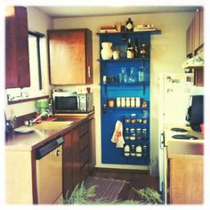 Our Tardis inspired shelving unit in our otherwise drab 1970's kitchen.