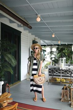 A striped dress with summer slides and a military jacket // Casual weekend style