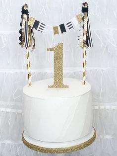 Custom Number Black White Striped Cake Topper Gold Glitter Number Tassel Bunting Cake Topper First Birthday Smash Cake topper by JulesandKenna on Etsy https://www.etsy.com/listing/228560888/custom-number-black-white-striped-cake