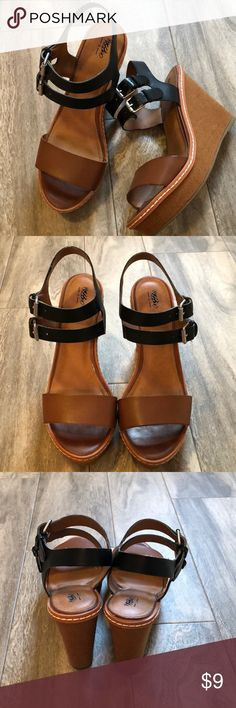 Cute wedges 😍 Brown and black strap wedges. 2 adjustable buckles around the ankle. Great condition only worn a couple of times. About a 4.5 inch heel. Bundle with any other item in my closet and save 20%! Mossimo Supply Co. Shoes Wedges