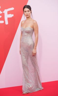 Bella Hadid blessed us with another shimmering naked dress look on the Fashion for Relief red carpet.