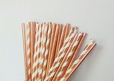 Set of assorted rose gold foil paper straws. Assortment includes: ♥ solid rose gold foil straws ♥ rose gold foil and white swirl striped  These paper straws would be perfect for a birthday party, baby shower, wedding, bridal shower or really any special event. These give an upgraded look to your drinks and work well in most drinks like cocktails and mixed drinks, sangria, juices, sodas and teas. These can also be used as cake pop and dessert sticks for your dessert bar/table or candy buf...