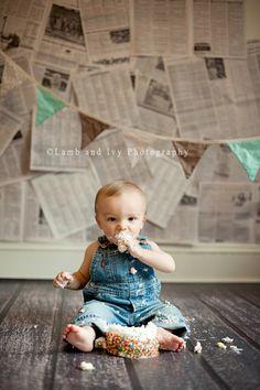 Newspaper backdrop Cake Smash~cute idea could easily make a newspaper backdrop!
