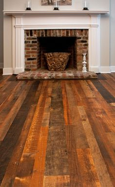 Love the richness of this flooring combined with the texture of the brick fireplace!