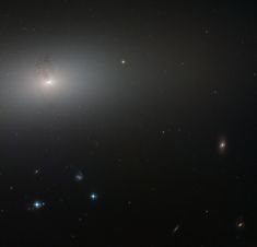 NGC 2768 is an elliptical galaxy in the constellation of Ursa Major (The Great Bear). It is a huge bundle of stars, dominated by a bright central region, where a supermassive black hole feasts on a constant stream of gas and dust being fed to it by its galactic host.