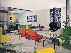 50's interior. Love the red chairs, green sofa and fireplace