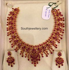 22 carat gold broad and intricate ruby necklace and matching earrings from Premraj Shantilal Jewellers. For price inquiries contact them on WhatsApp: 9700009000