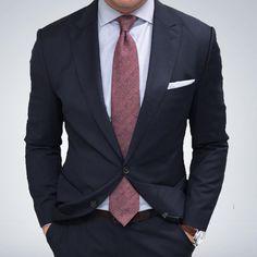 Wool herringbone tie and single breasted suit.