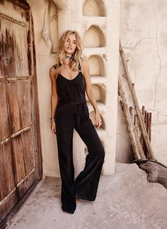 Model Rosie Huntington-Whiteley poses in Paige Denim's Hazelle jumpsuit