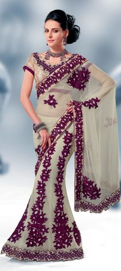 83039: Beige and Brown color family Saree with matching unstitched blouse.