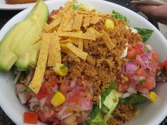 Native Foods- Yo Amigo Taco Salad: A blend of romaine, cabbage, Native Taco Meat, and salsa fresca. Topped with corn, green onion, cilantro, and tortilla chip croutons. Served with our original creamy chipotle dressing on the side. (Added avocado and no green onions) Photo by Vegan Cowgirl http://www.vegancowgirl.com/1/archives/05-2013/1.html #VeganCowgirl