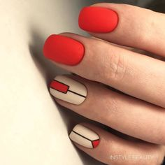 Geometrical red, nude and black nail art.