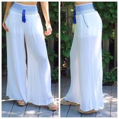 Hamptons White Palazzo Pants Stunning Hamptons off white palazzo pants // Royal blue stitching + tassel at waist // The most comfortable pants for a day out or dress them up to dinner oceanside // Wide leg // Built in shorts // So soft very luxurious  // This type of stretch waistband is my favorite as it is the most flattering + makes the waist itty bitty // Brand new // Sizes M or L. S is sold out. Photos are my own // Price is firm unless bundling *Note my pictures show pants as true…