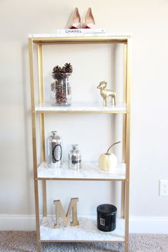 The easiest DIY hack to glam your $14.99 Ikea Hyllis Shelf Unit into marble and gold shelves.