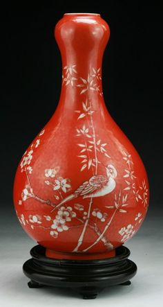 "A Chinese Antique Iron Red Porcelain Vase presented on wood stand, of Qing Dynasty; Size: H: 11-1/2""; (overall) H: 12-3/4"""
