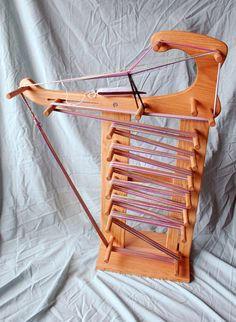 Harpsichord inkle loom. Top detaches to be used as table loom. Makes 18 ft band when warped full length.