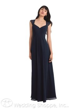 A sophisticated cap sleeve bridesmaid dress with illusion back.