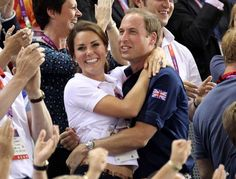 Prince William, Duke of Cambridge and Catherine, Duchess of Cambridge stand up and cheer as they attend the track cycling event held at at the Velodrome