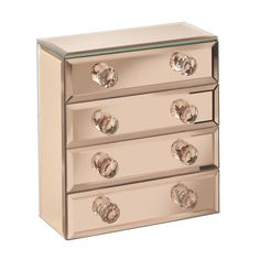 Features: -Features four spacious drawers with soft gray velvet protective lining and foam stoppers. -Sturdy frame with on trend gold glass mirrored sides and crystallized handles. -Includes a glas