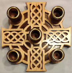 "This Advent wreath is in diameter and features a cross with a Celtic rope design. The overlay is ¼"" maple and the backer is ½"" walnut. The candle cups are walnut with brass cup rings. Designed by Sue Mey. Third Sunday Of Advent, Irish Christmas, Cheap Christmas, Christmas Candle, Handmade Christmas, Christmas Ideas, Candle Cups, Saw Wood, Maple Walnut"
