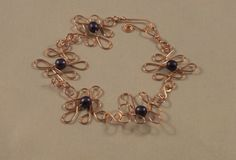 Wire Wrapped Copper and Druk Bead Bracelet by AttitudesInLiving, $29.00