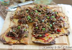 Tasty looking pizza with beef roast slow cooked in pineapple juice. (Only I'd make is without white onions and with spicy banana peppers instead of red peppers... and maybe throw some extra pineapple on top.) I can't wait to try it!